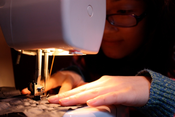 Qingyun learns how to use a sewing machine